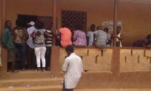 A queue of impatient registrants outside the registration center at Congo Town