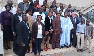 Officials and participants at the labour training