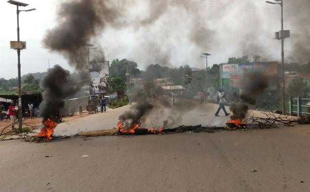 Burning tyres on the main highway in Bo