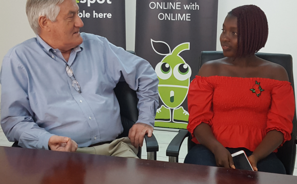 Onlime's Stuart Bentham listening to Hawanatu's accounts