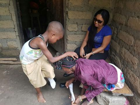 Zainab taking care of her son from school as Linda Jaward looks on